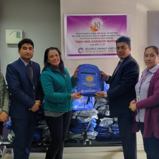Reliance Finance Limited in collaboration with Lions Club International organized the school bag handover program